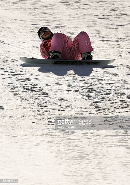 Melo Imai of Japan sits on the snow after falling in the Womens Snowboard Half Pipe Qualifying on Day 3 of the 2006 Turin Winter Olympic Games on...