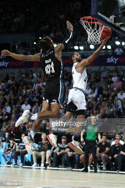 Melo Trimble of Melbourne shoots under pressure from Glen Rice Jnr of the NZ Breakers during the round 6 NBL match between the New Zealand Breakers...