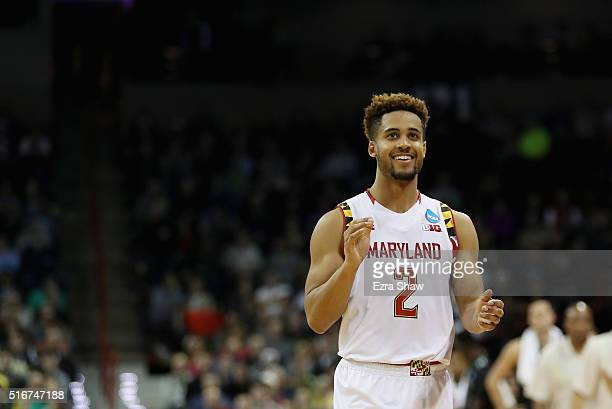 Melo Trimble of the Maryland Terrapins celebrates their 7360 win over the Hawaii Warriors in the second half during the second round of the 2016 NCAA...
