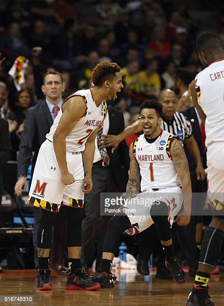 Melo Trimble of the Maryland Terrapins celebrates with teammte Jaylen Brantley in the second half against the Hawaii Warriors during the second round...