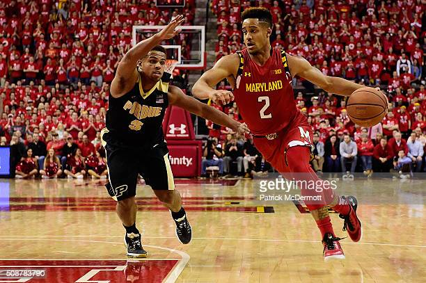 Melo Trimble of the Maryland Terrapins dribbles the ball against PJ Thompson of the Purdue Boilermakers in the second half during their game at...
