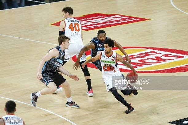 Melo Trimble of the Taipans comes off a pick and roll with teammate Alex Loughton during the round five NBL match between the New Zealand Breakers...