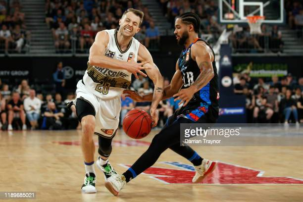 Melo Trimble of United defends Nathan Sobey of the Bullets during the round 8 NBL match between Melbourne United and the Brisbane Bullets at...