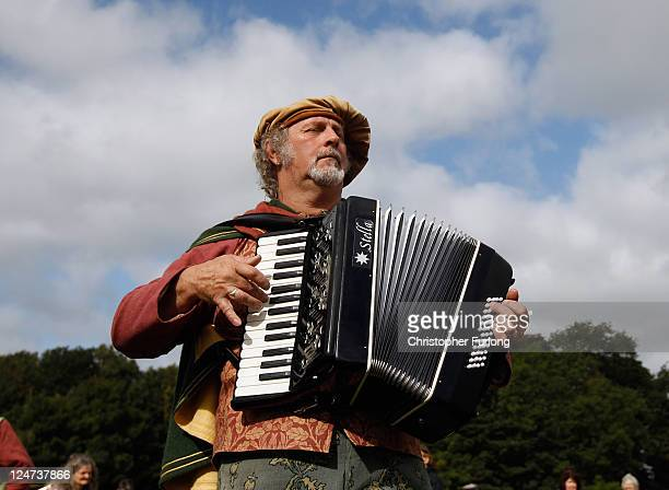 A melodian player accompanies the Abbots Bromley Horn Dance on September 12 2011 in Abbots Bromley United Kingdom The dance comprising of six Deermen...
