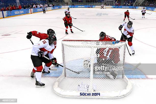 Melodie Daoust of Canada scores a goal against Florence Schelling of Switzerland in the first period during the Women's Ice Hockey Playoffs Semifinal...