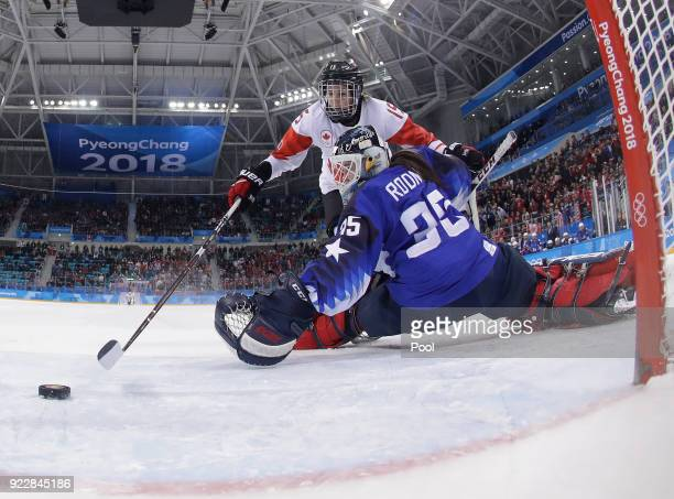 Melodie Daoust of Canada scores a goal against goalie Maddie Rooney of the United States in the penalty shootout during the Women's Gold Medal Game...
