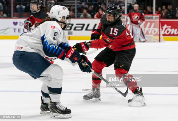 Melodie Daoust of Canada shoots the puck past Megan Bozek of the United States during women's hockey action in Game of the 2020 Rivalry Series at...