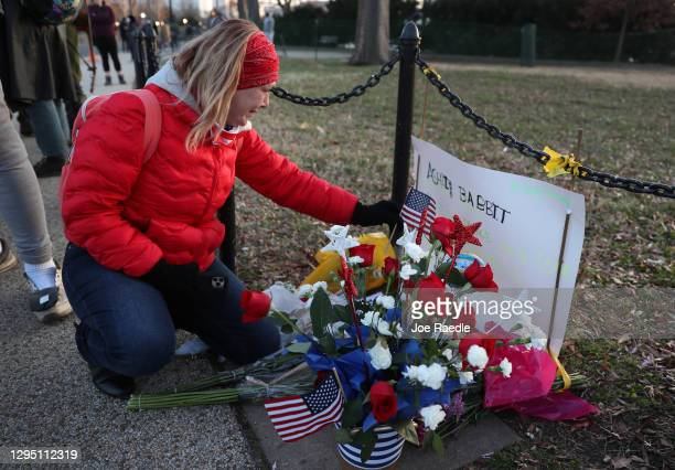 Melody Black, from Minnesota, becomes emotional as she visits a memorial setup near the U.S. Capitol Building for Ashli Babbitt who was killed in the...