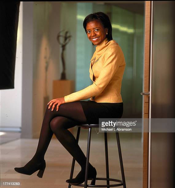Melody Hobson, African-American businesswoman, sitting on stool, undated.