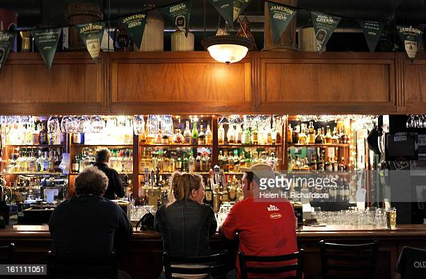 Melody Schneberger left and Richie Heinisch enjoy some of Nallen's Irish Pub's popular draft beers at the bar The Irish Pub at 1429 Market Street and...
