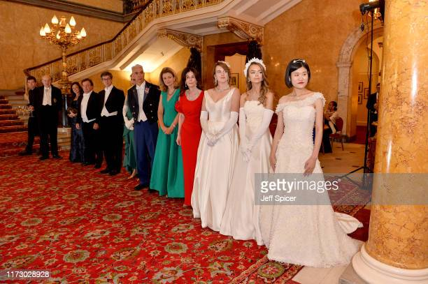 Melody Zhao, Debutante of the Year, attends Queen Charlotte's Ball at Lancaster House on September 07, 2019 in London, England. This year, the cake...