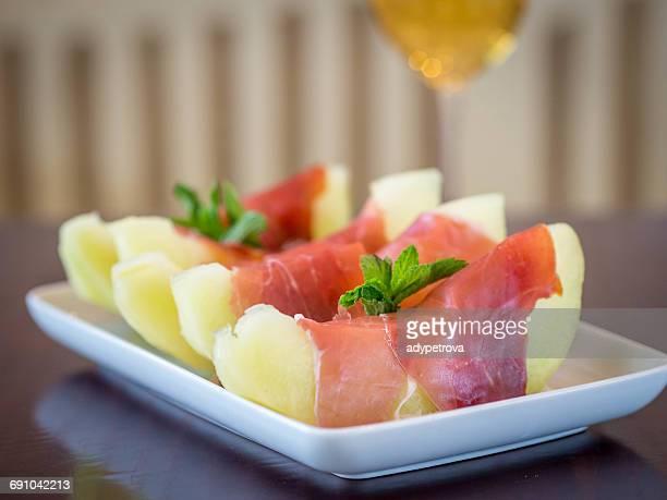 Melon wrapped in parma ham