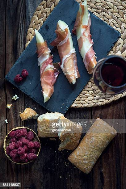 Melon wrapped in parma ham with bread