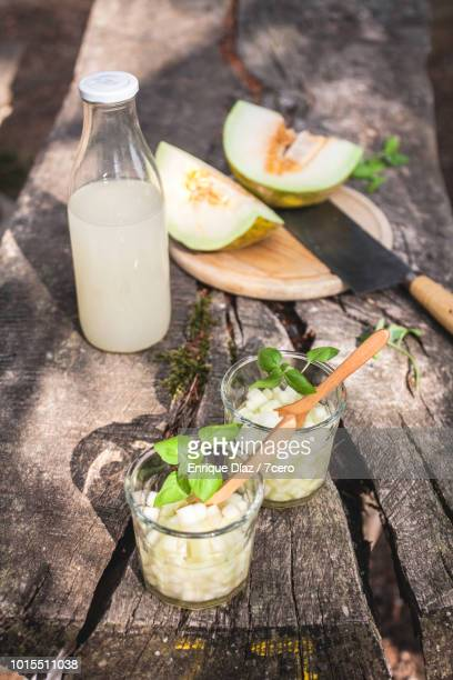 Melonade on a Wooden Picnic Table in the Forest