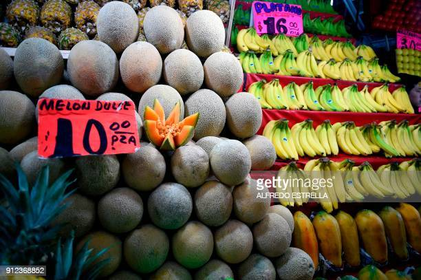 Melons and bananas are on display at the 'Central de Abasto' wholesale market in Mexico City on January 30 2018 Until the first half of January...