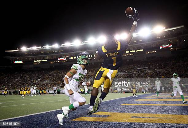 Melquise Stovall of the California Golden Bears leaps up for a pass in the endzone while covered by Troy Dye of the Oregon Ducks at California...