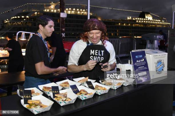 Melt Shop prepares burgers at the Food Network Cooking Channel New York City Wine Food Festival Presented By CocaCola Blue Moon Burger Bash presented...
