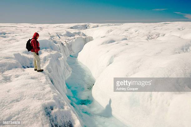 Melt water on the Greenland ice sheet near camp Victor north of Ilulissat. The Greenland ice sheet is the largest ice sheet outside of Antarctica. Temperatues have risen by nine degrees fahrenheit in Greenland in the last 60 years due to human induced cli