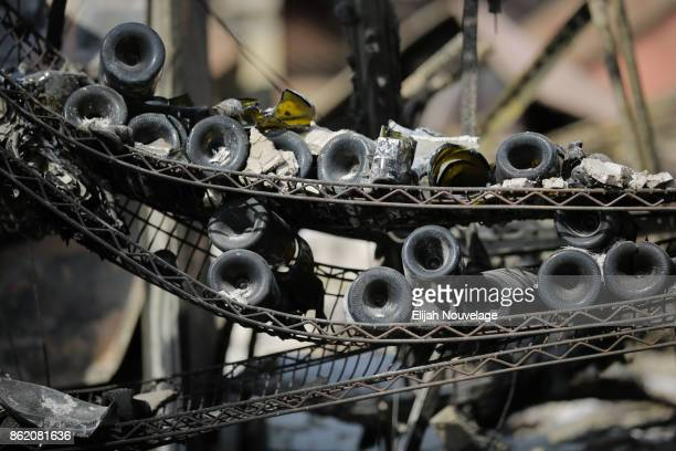 Melted and broken wine bottles are seen at the remains of the Signorello VIneyard on October 16 2017 in Napa California At least 40 people were...