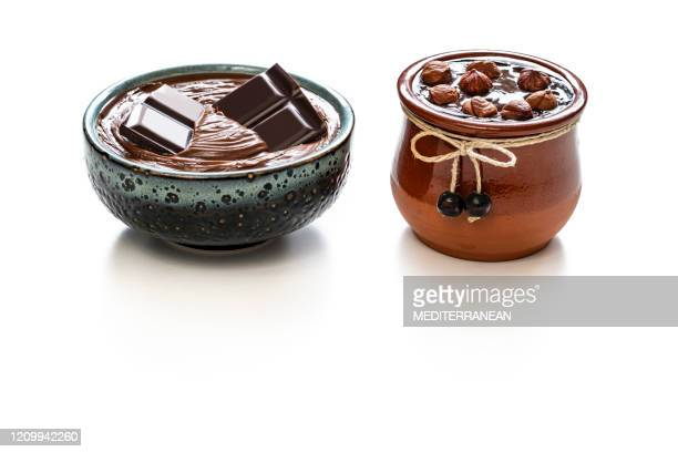 melted chocolate cream two pots with hazelnuts pot and blue bowl - antioxidant stock pictures, royalty-free photos & images