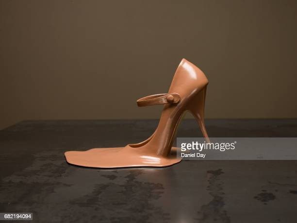 Melted shoe on a metal table
