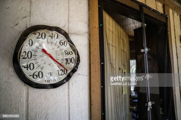 A melted thermometer is stuck at 110 degrees outside the door of resident Daniel Brown's home after the Clayton Fire destroyed a part of his house in...