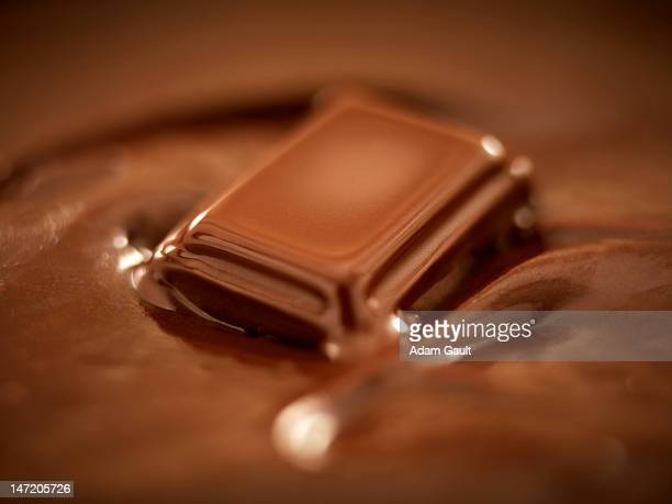 melting chocolate - chocolate stock pictures, royalty-free photos & images