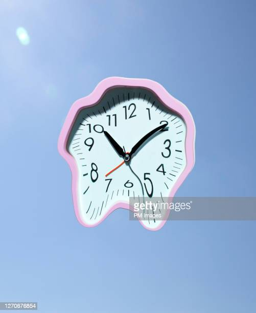 melting clock - destruction stock pictures, royalty-free photos & images