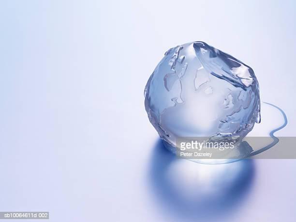 Melting ice in shape of globe, close-up