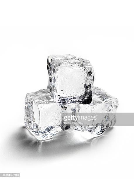 melting ice with copy space - ice cube stock photos and pictures