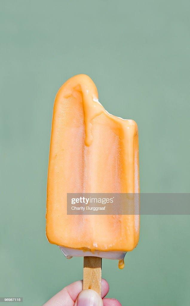 Melting Orange Popsicle : Stock Photo