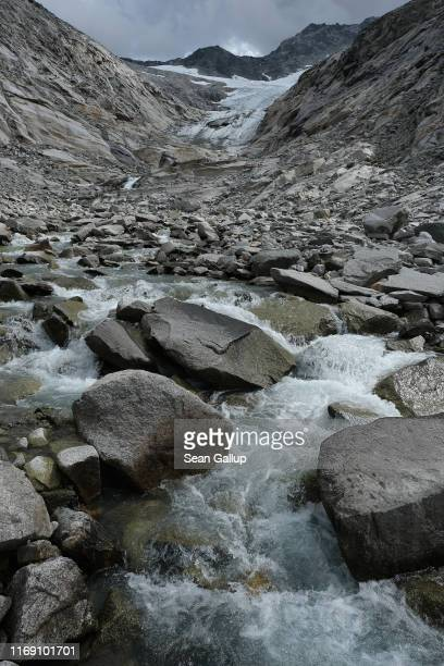 Meltwater flows down from the retreating Hornkees glacier in the Zillertal Alps on August 15, 2019 near Ginzling, Austria. Glaciers in the region...