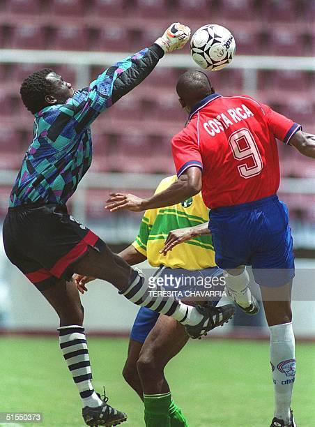Melvin Andrews of the Saint Vincent select soccer team tries to block the ball in front of Costa Rican player Pablo Cesar Wanchope 09 July 2000...