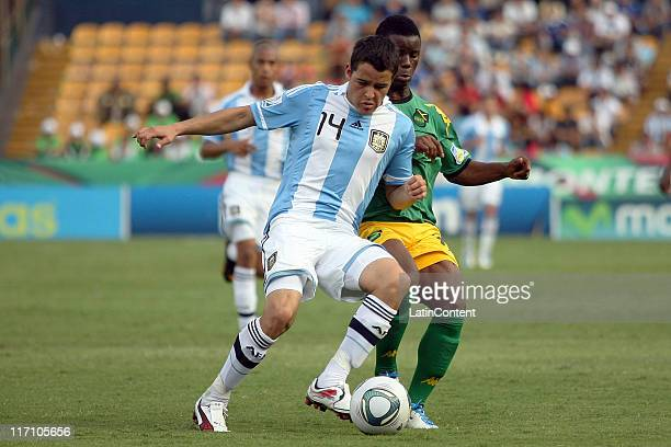 Melvin Blair of Jamaica struggles for the ball with Alexis Zarate of Argentina during the FIFA U17 World Cup Mexico 2011 Group B match between...