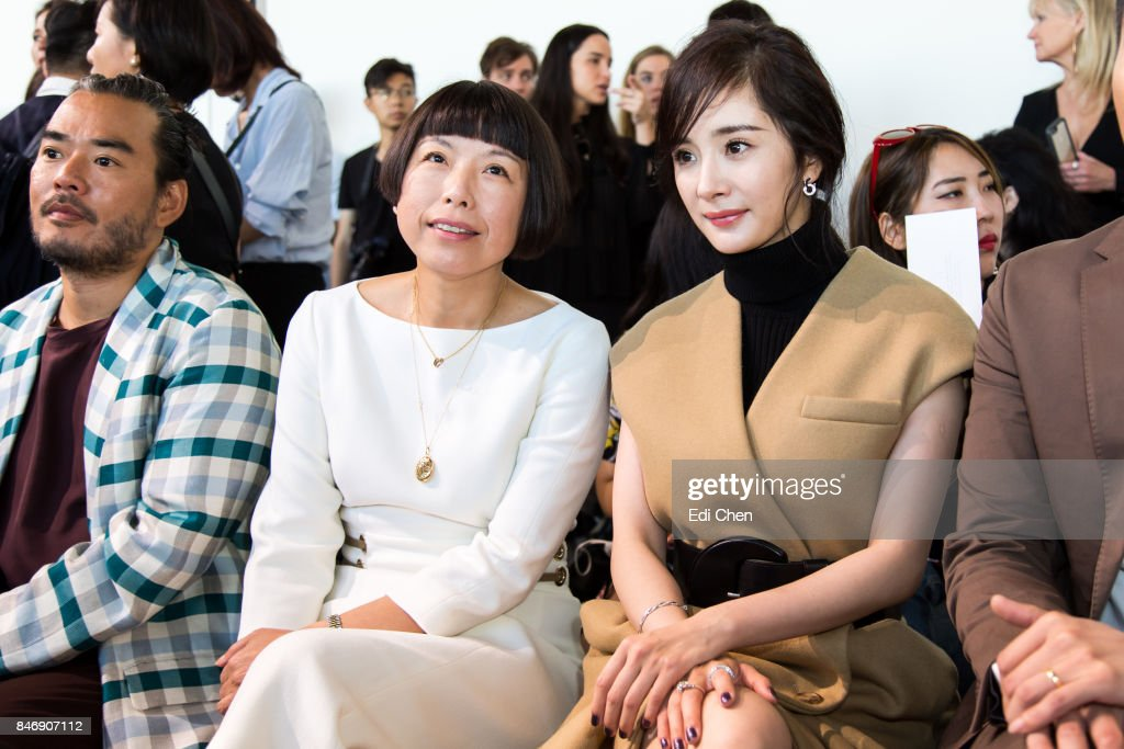 Melvin Chua, Angelica Cheung & Yang Mi attend the Michael Kors runway show during New York Fashion Week at Spring Studios on September 13, 2017 in New York City.