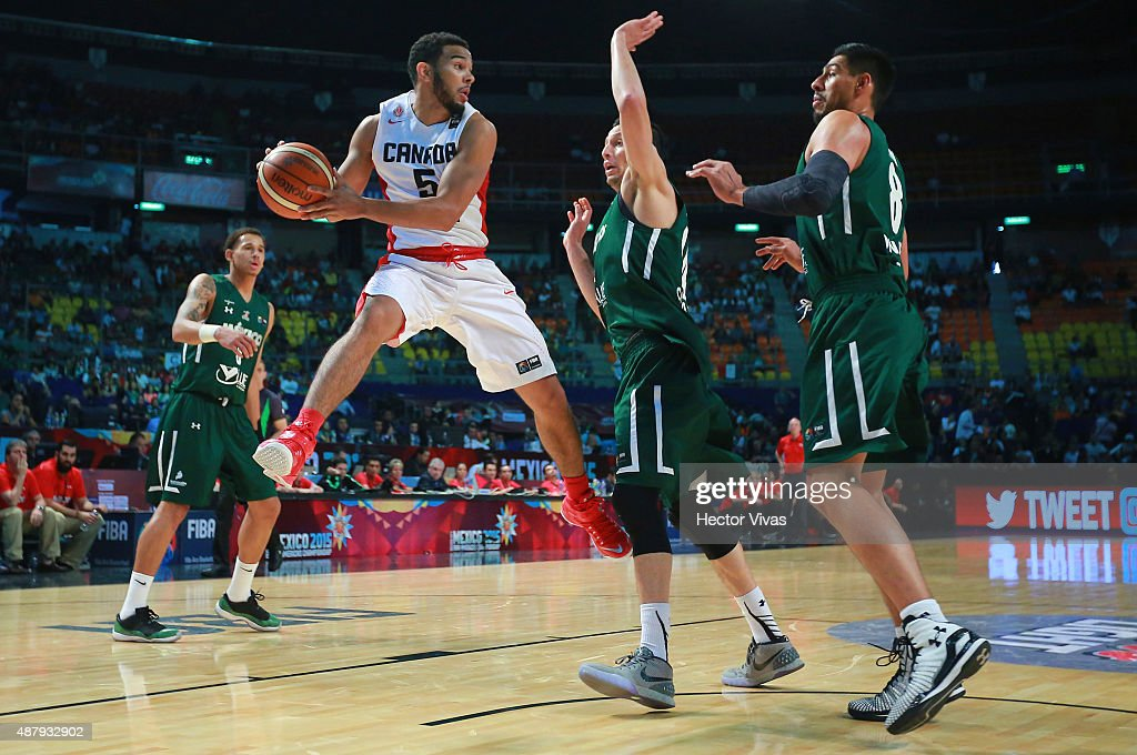 Melvin Ejim of Canada handles the ball against Adrian Zamora and Gustavo Ayon of Mexico during a third place match between Canada and Mexico as part of the 2015 FIBA Americas Championship for Men at Palacio de los Deportes on September 12, 2015 in Mexico City, Mexico.
