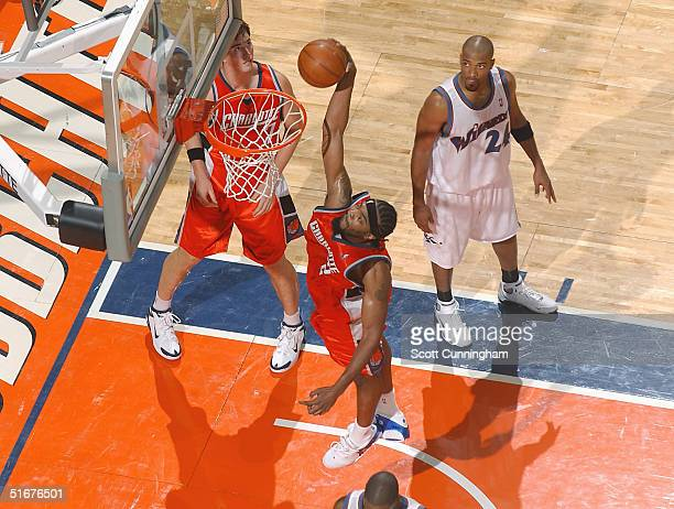 Melvin Ely of the Charlotte Bobcats dunks against the Washington Wizards in a game on November 4 2004 at the Charlotte Coliseum in Charlotte North...