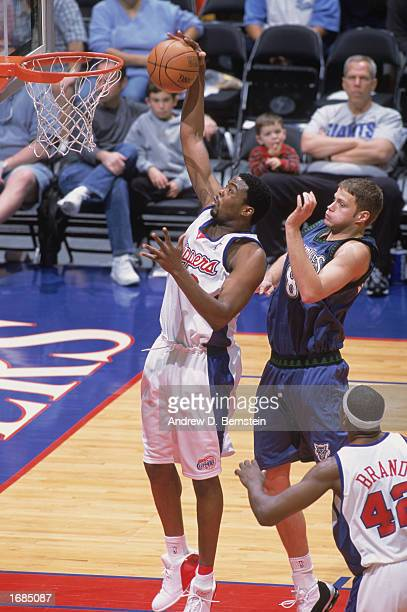 Melvin Ely of the Los Angeles Clippers makes a dunk against Radoslav Nesterovic of the Minnesota Timberwolves at Staples Center on December 7 2002 in...