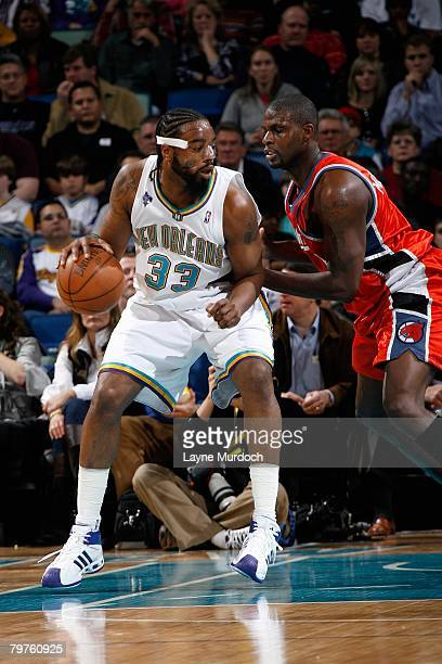 Melvin Ely of the New Orleans Hornets dribbles against Nazr Mohammed of the Charlotte Bobcats during the game on January 18 2008 at the New Orleans...