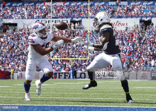 Melvin Gordon III of the Los Angeles Chargers catches a touchdown pass for his third touchdown of the game in the second quarter during NFL game...