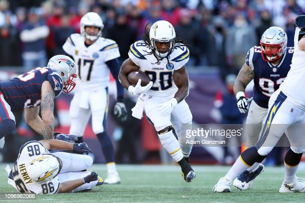 Melvin Gordon III of the Los Angeles Chargers runs with the football during the AFC Divisional Playoff Game against the New England Patriots at...