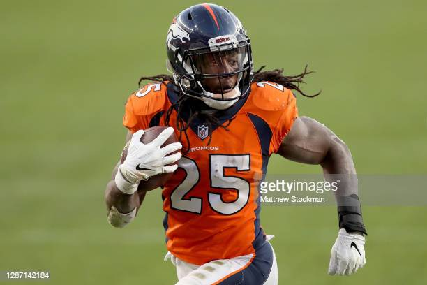 Melvin Gordon of the Denver Broncos carries the ball for a touchdown against the Miami Dolphins to take a 2010 during the third quarter at Empower...