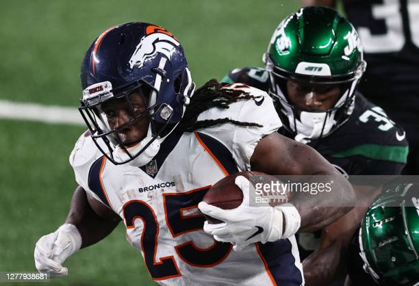 Melvin Gordon of the Denver Broncos runs for a touchdown against the New York Jets during the fourth quarter at MetLife Stadium on October 01, 2020...