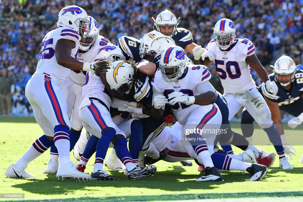 Melvin Gordon #28 of the Los Angeles Chargers is hit by Adolphus Washington #92 of the Buffalo Bills during the second quarter of the game at StubHub Center on November 19, 2017 in Carson, California.