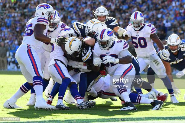 Melvin Gordon of the Los Angeles Chargers is hit by Adolphus Washington of the Buffalo Bills during the second quarter of the game at StubHub Center...