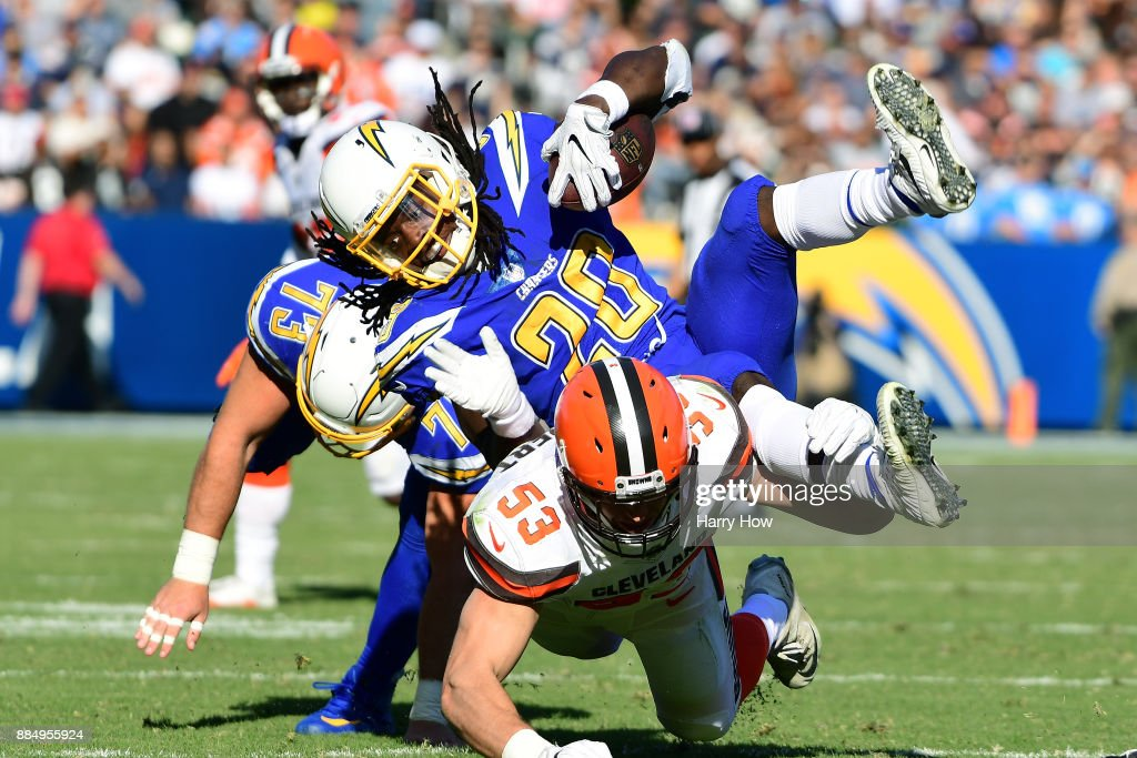 Melvin Gordon #28 of the Los Angeles Chargers is hit by Joe Schobert #53 of the Cleveland Browns during the second quarter of the game at StubHub Center on December 3, 2017 in Carson, California.