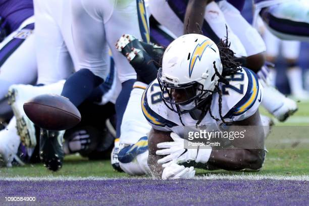 Melvin Gordon of the Los Angeles Chargers loses the ball on the 1 yard line against the Baltimore Ravens during the fourth quarter in the AFC Wild...