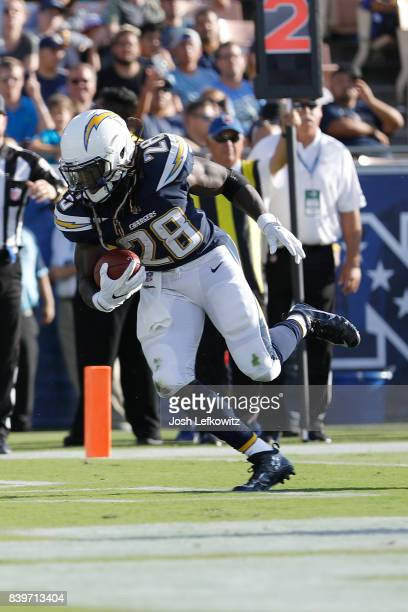 Melvin Gordon of the Los Angeles Chargers runs the ball down field during the preseason game between the Los Angeles Rams and Los Angeles Chargers at...