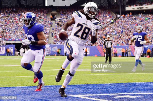 Melvin Gordon of the Los Angeles Chargers runs the ball for a second quarter touchdown against the New York Giants during an NFL game at MetLife...