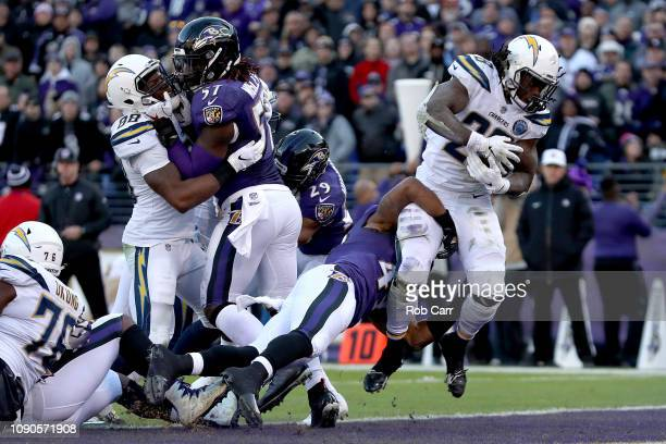 Melvin Gordon of the Los Angeles Chargers scores a one yard touchdown against the Baltimore Ravens during the fourth quarter in the AFC Wild Card...